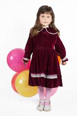 Portrait of preschooler girl in velvet dress