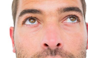 Close man looking up