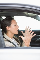 Young woman experiencing road rage