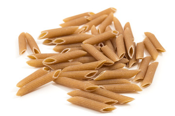 Closeup of pile of uncooked penne rigate pasta, isolated