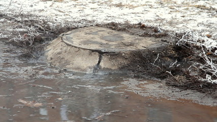water flows over the road from the sewer