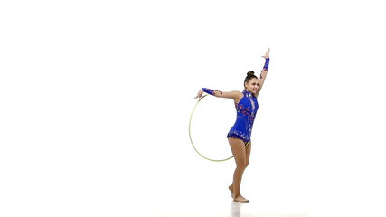 Portrait of young beautiful  woman gymnast  with hula hoop, slow