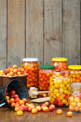 Preserving Mirabelle plums - jars of homemade fruit preserves