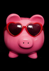 piggy bank wearing red heart sunglasses