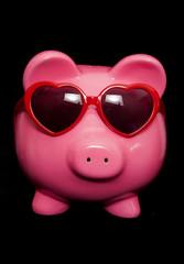 piggy bank wearing red heart sunglasses