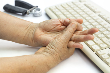 Senior woman painful finger due to prolonged use of keyboard and