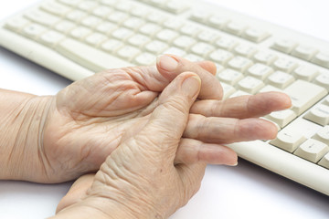 Senior woman painful finger due to prolonged use of keyboard