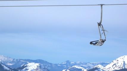 Ski lift chairs on hillside, Alps, Austria