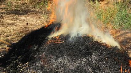 Burning of straw with smoke