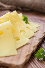Sliced Cheese on wooden background