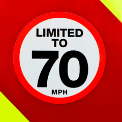 Speed limited sign on the back of a vehicle with high visibility