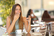 Woman yawning while is working at breakfast in a restaurant - 78047435