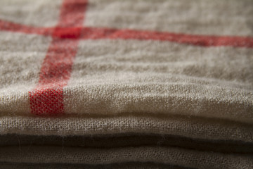 Background close up of a hessian scarf fabric folded