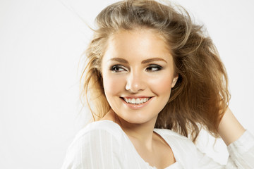 smiling blonde girl on white background with flowing hair