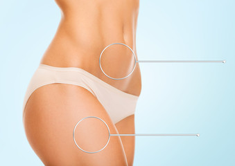 close up of woman hips and torso with magnifier