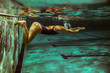 Swimmer at the swimming pool.Underwater photo. - 78048876