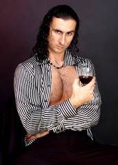 Beautiful man in an erotic image with glass of wine