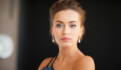 woman with diamond earrings