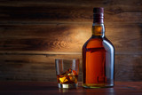Bottle of whiskey on a wooden background