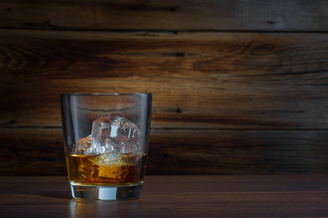 whiskey on a wooden background