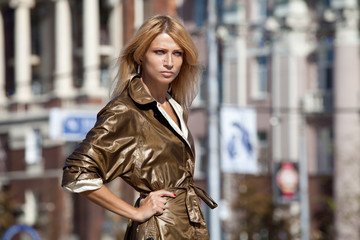 Fashion woman in autumn city