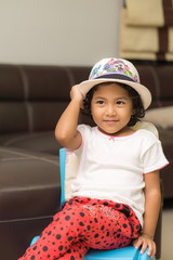 The girl with colorful hat
