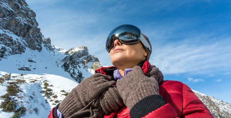 woman wearing a ski mask in the mountains