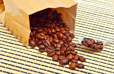Сoffee beans on the package on the tablecloth