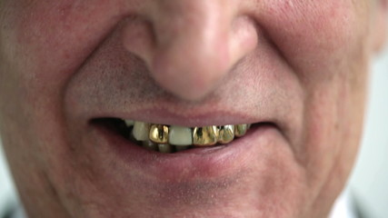 Smiling old man with gold teeth