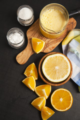 orange juice on dark. cooking ingredients. potato starch and sug