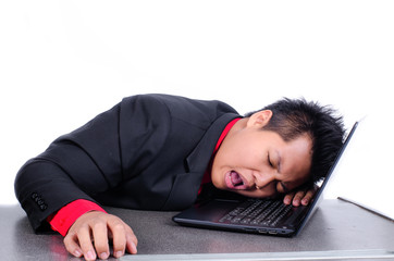 young business man sleeping on his laptop