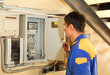 Electrician looks  into electric  distribution fuseboard