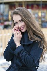 Young beautiful woman in stylish dark gray wool coat
