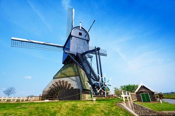 Old rotating water pumping windmill in Holland