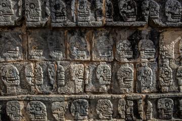 Skulls texture carved stone