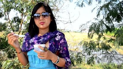 Thai woman eating Ice cream