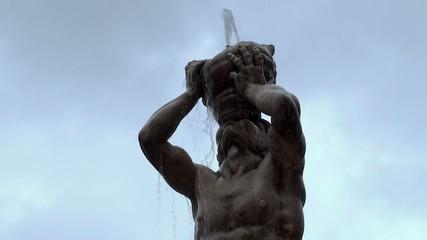 Triton torso with conch of Fontana del Tritone. Rome
