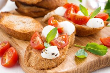 bruschetta with mozzarella, basil and cherry tomatoes