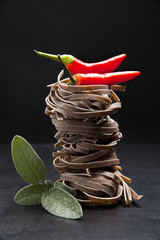 nest of raw pasta with sage & hot red pepper. lifestyle. pizzocc