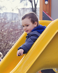Child on playground slide