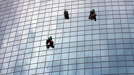 window cleaners at work on skyscraper