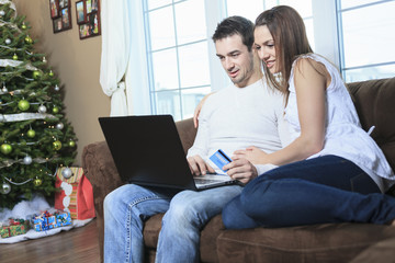 A Couple using credit card to shop on internet