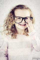 Smiling little girl with glasses