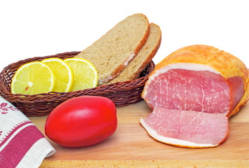 Ham , bread and vegetables on a white background.