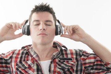 A Handsome guy enjoying music on headphones,