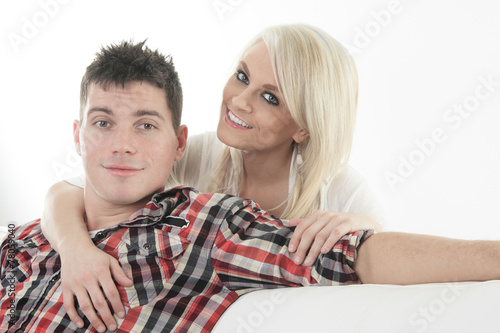 canvas print picture A Young beautiful couple on a sofa at home