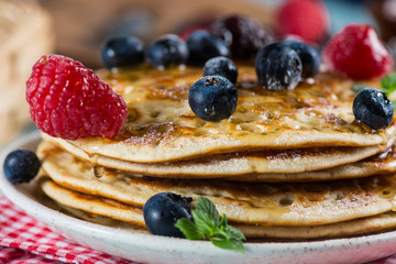 Delicious summer breakfast with fresh berries fruits and sirup