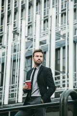 Handsome Businessman Drinking Coffee in a Financial District