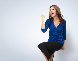 Happy gesturing businesswoman