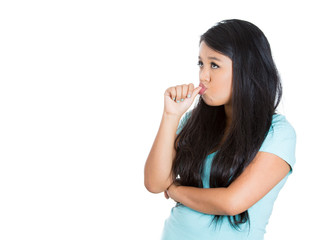 Clueless lazy young woman sucking thumb doing nothing